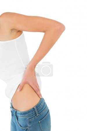 Mid section of a woman suffering from back pain