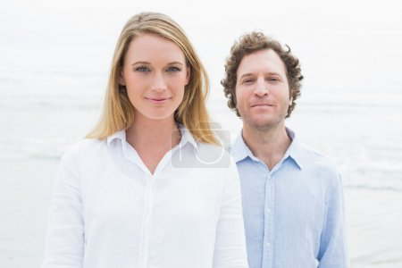 Portrait of a smiling casual couple at beach