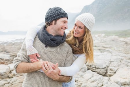 Romantic couple together on rocky landscape