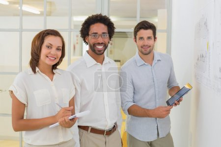 Photo for Portrait of smiling business people with digital tablet and notepad at the office - Royalty Free Image