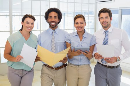 Photo for Portrait of a group of business colleagues holding folders in the office - Royalty Free Image