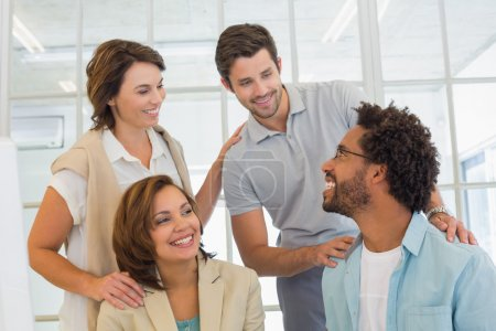 Photo for Group of young business people having a conversation in the office - Royalty Free Image
