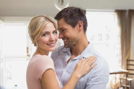 Photo for Side view portrait of a happy loving young couple at home - Royalty Free Image