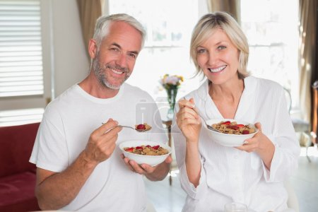 Photo for Portrait of a happy mature couple having breakfast at home - Royalty Free Image