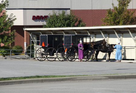 Amish horse and buggy and women, old and new
