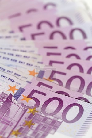 Vertical isometric stack of money with 500 euro banknotes