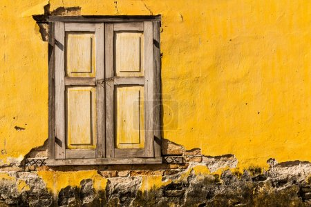 Vintage windows on old yellow brick wall