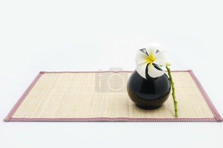 Hanging bamboo basket of flower.