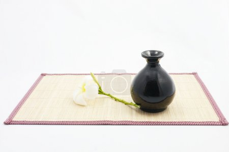 Bamboo basket and sheets with vase