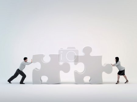 Teamwork, pushing each other toward the puzzle