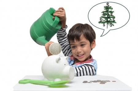 Litlle kid watering piggy bank for more money grow up