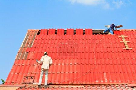 Worker repairing roof