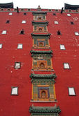 Buddhist bass reliefs on the main wall of Putuo Zongcheng monast