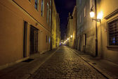 Night photo of a cobbled street in the old, historical part of P