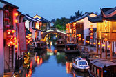 oil painting stylized photo of night view of  canal in old Suzho