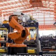 Robots welding in a production line...