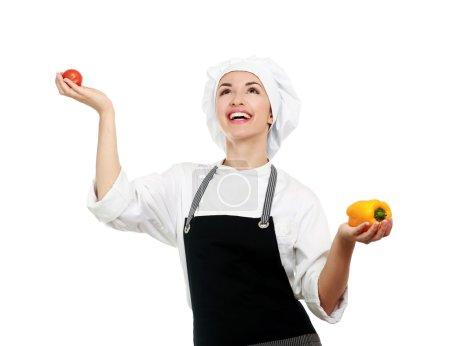 Photo pour Belle cuisinière aux légumes, un fond blanc sur - image libre de droit