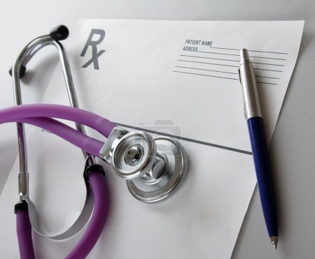 Photo for Close-up of stethoscope on prescription form isolated - Royalty Free Image
