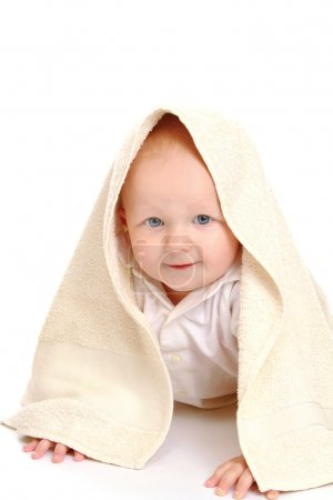 A baby covered with a towel