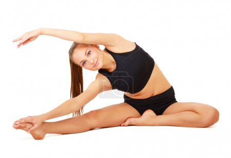 Smiling woman doing stretching excersises