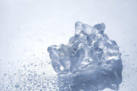 Photo for Melting ice on white - Royalty Free Image