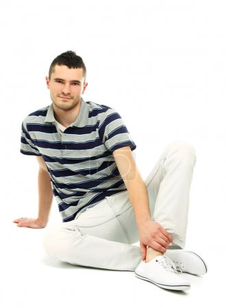 Young guy sitting on the floor