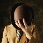 Man Hiding His Face