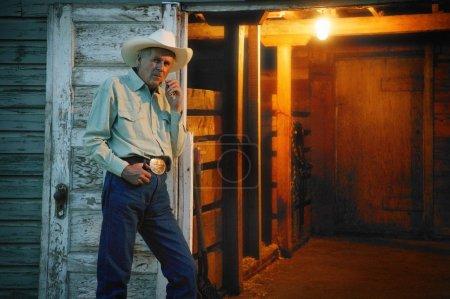 Cowboy Stands By Door