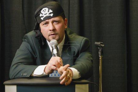 Speaker Wearing Pirate Headgear...