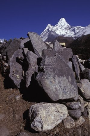Pile Of Boulders And Rocks In Front Of Mountain