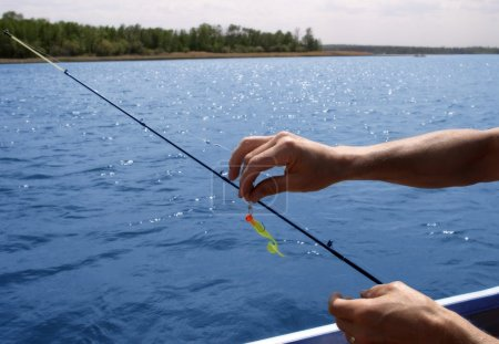 Lure Being Put On Fishing Line