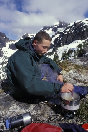 Mountaineer Using A Camping Stove
