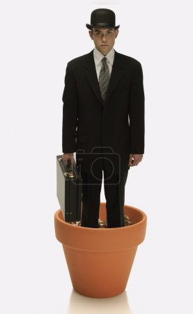 Man In Suit Standing In A Flower Pot