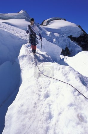 Mountaineer On Snowy Slope