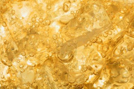 Photo pour Un fond jaune liquide - image libre de droit