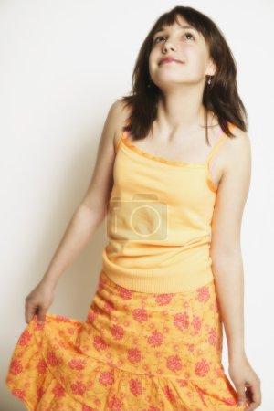 A Girl Twirls Skirt
