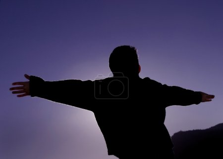 Young Boy With Arms Out Stretched