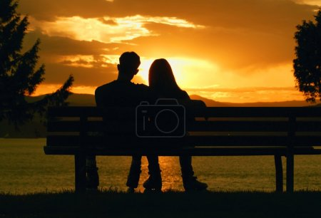 Couple Enjoy A Romantic Sunset
