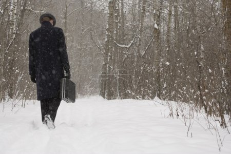 Businessman Walking Through The Snow
