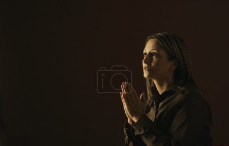 Photo for A Woman In Prayer - Royalty Free Image