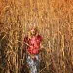Girl Walking Through A Field...