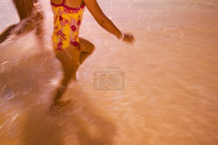 Children Run Through The Water