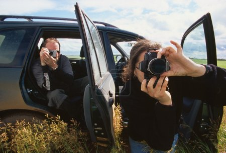 Foto de Fotógrafos usando cámaras - Imagen libre de derechos