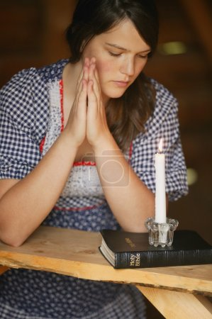 Photo for Woman Prays - Royalty Free Image