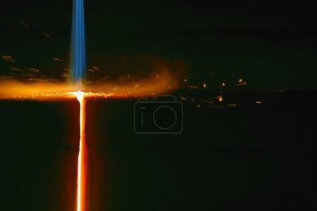 Closeup Of Flame Cutting A Bar Of Steel