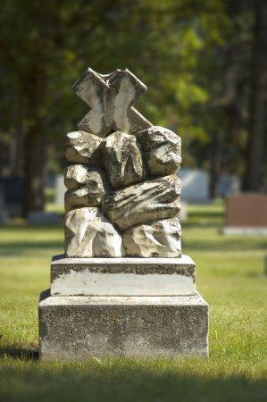 Headstone In Graveyard