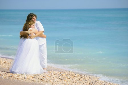 Parent Embracing Child On The Beach...