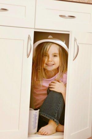 Child Hides In Kitchen Cupboard