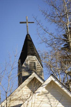 Weathered Cross On Steeple Of Church