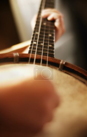 Person Playing The Banjo